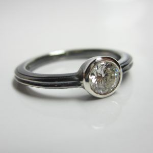 HJ_BESPOKE_Oxidised silver with Half Carat Diamond