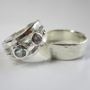 HJ_BESPOKE_left silver with birthstones Aquamarine and Diamond. Right 9ct white hammered band