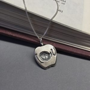 Sherlock-Moriarty's-Apple-Pendant